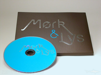 silver and blue foil stamping on wide digipak