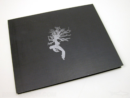 custom 2 CD Book album with swinging sleeve and inner pages